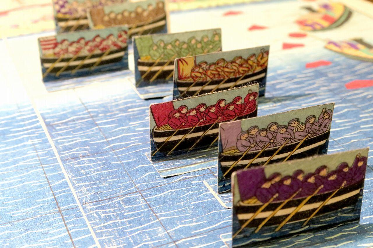 KUNITOSHI <i>Shimpan Sumidagawa kyoso sugoroku</i> (<i>Sugoroku</i> game of rawing on Sumida River), with eight pieces of boats