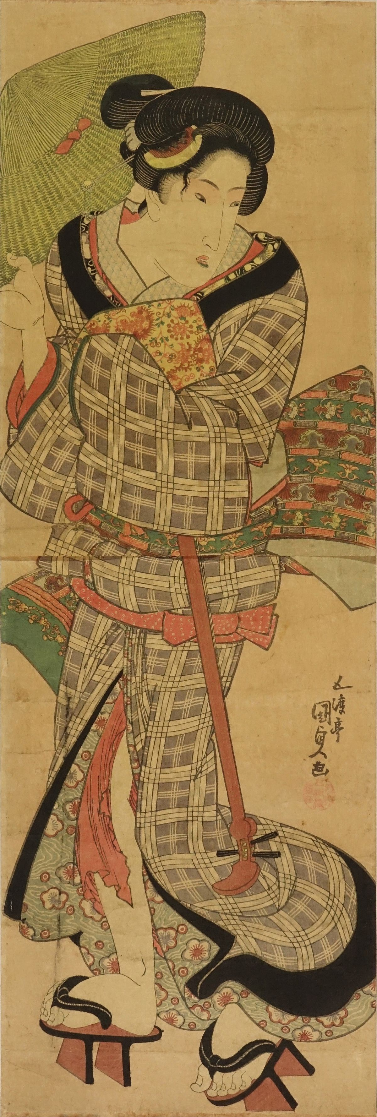 KUNISADA A beauty holding a shamisen, vertical diptych